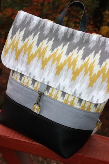 "The ""Handy Haversack"" in yellow and gray chevron pattern with black faux leather accent."